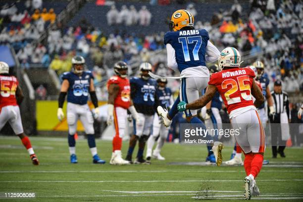 Davante Adams of the Green Bay Packers in action against Xavien Howard of the Miami Dolphins during the 2019 NFL Pro Bowl at Camping World Stadium on...