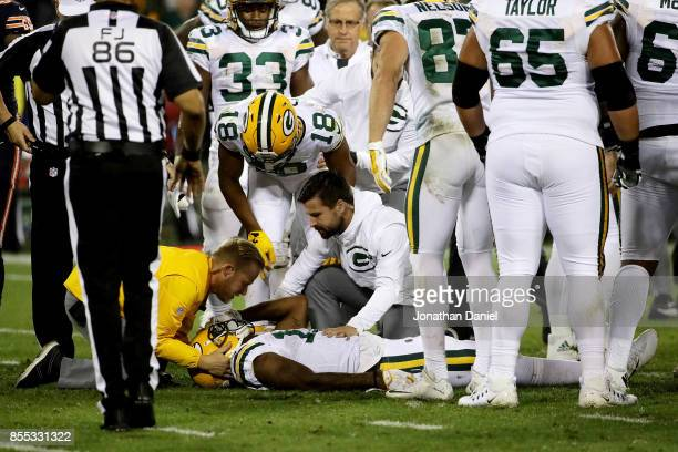 Davante Adams of the Green Bay Packers is attended to after being injured in the third quarter against the Chicago Bears at Lambeau Field on...