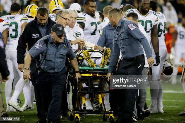 Davante Adams of the Green Bay Packers is carted off the field after being injured in the third quarter against the Chicago Bears at Lambeau Field on...