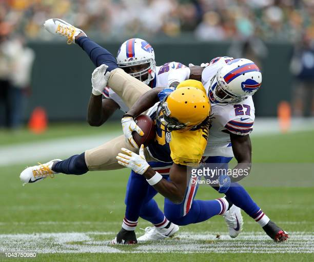 Davante Adams of the Green Bay Packers is tackled by Tre'Davious White of the Buffalo Bills during the second quarter of a game at Lambeau Field on...
