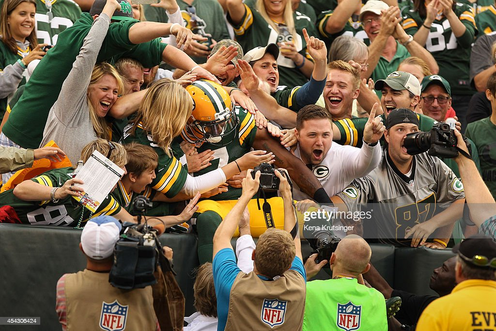 Davante Adams #17 of the Green Bay Packers jumps into the crowd after scoring in the first quarter in the preseason game against the Kansas City Chiefs on August 28, 2014 at Lambeau Field in Green Bay, Wisconsin.
