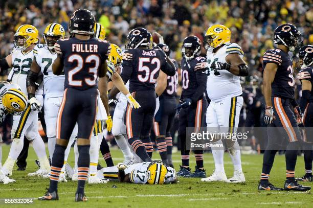 Davante Adams of the Green Bay Packers lays on the field after being injured in the third quarter against the Chicago Bears at Lambeau Field on...