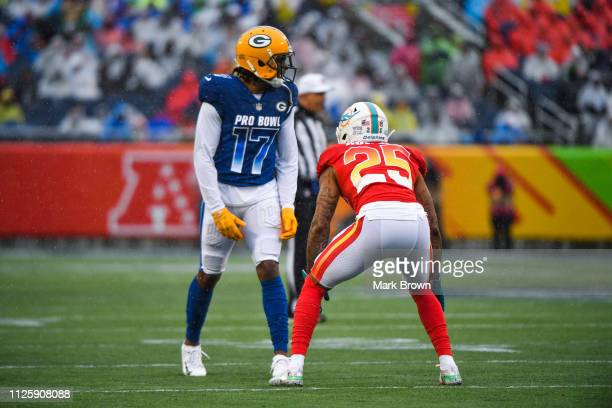 Davante Adams of the Green Bay Packers lines up against Xavien Howard of the Miami Dolphins during the 2019 NFL Pro Bowl at Camping World Stadium on...