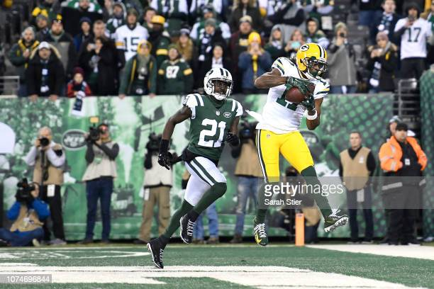 Davante Adams of the Green Bay Packers makes a catch from Aaron Rodgers for a touchdown to win the game in overtime against the New York Jets during...
