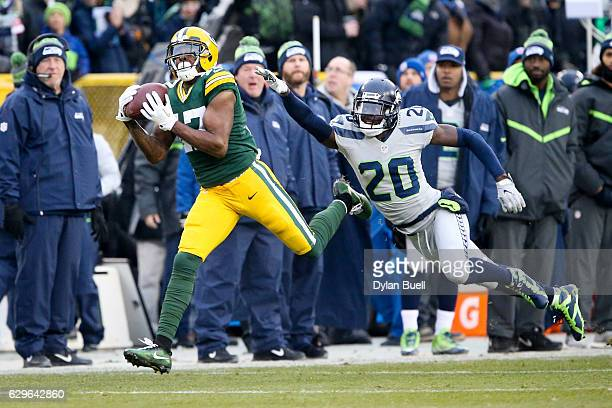 Davante Adams of the Green Bay Packers makes a catch past Jeremy Lane of the Seattle Seahawks in the first quarter at Lambeau Field on December 11...
