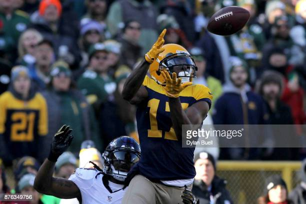 Davante Adams of the Green Bay Packers makes a catch while being guarded by Brandon Carr of the Baltimore Ravens in the first quarter at Lambeau...