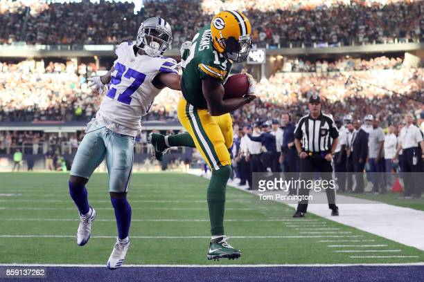 Davante Adams of the Green Bay Packers pulls in the game winning touchdown against Jourdan Lewis of the Dallas Cowboys in the fourth quarter at ATT...