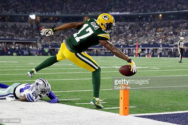 Davante Adams of the Green Bay Packers reaches for the end zone past Morris Claiborne of the Dallas Cowboys in the first half during the NFC...