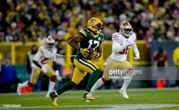 Davante Adams of the Green Bay Packers runs after making a reception during the game against the San Francisco 49ers at Lambeau Field on October 15...
