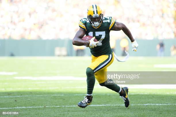 Davante Adams of the Green Bay Packers runs for yards during a game against the Cincinnati Bengals at Lambeau Field on September 24 2017 in Green Bay...