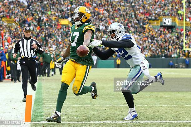 Davante Adams of the Green Bay Packers runs into the endzone past Barry Church of the Dallas Cowboys for a touchdown in the third quarter of the 2015...