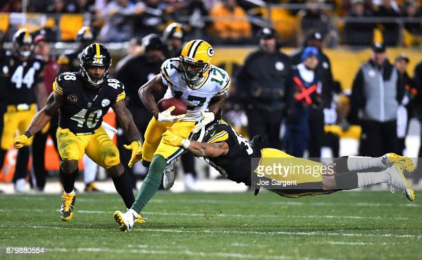 Davante Adams of the Green Bay Packers runs upfield after a catch in the fourth quarter during the game against the Pittsburgh Steelers at Heinz...