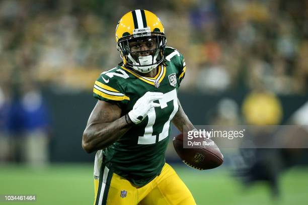 Davante Adams of the Green Bay Packers runs with the ball in the second quarter against the Chicago Bears at Lambeau Field on September 9 2018 in...