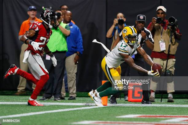 Davante Adams of the Green Bay Packers scores a 33yard receiving touchdown during the fourth quarter against the Atlanta Falcons at MercedesBenz...
