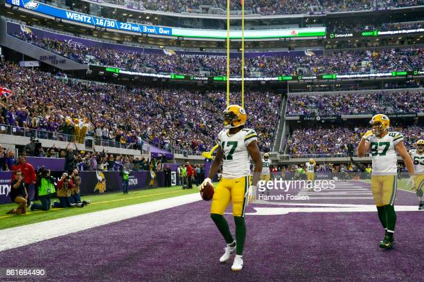 Davante Adams of the Green Bay Packers scores a touchdown after a 14 yard reception during the second quarter of the game on October 15 2017 at US...