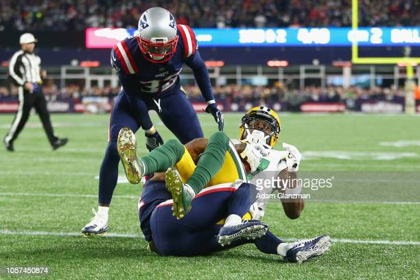 Davante Adams of the Green Bay Packers scores a touchdown during the second quarter against the New England Patriots at Gillette Stadium on November...
