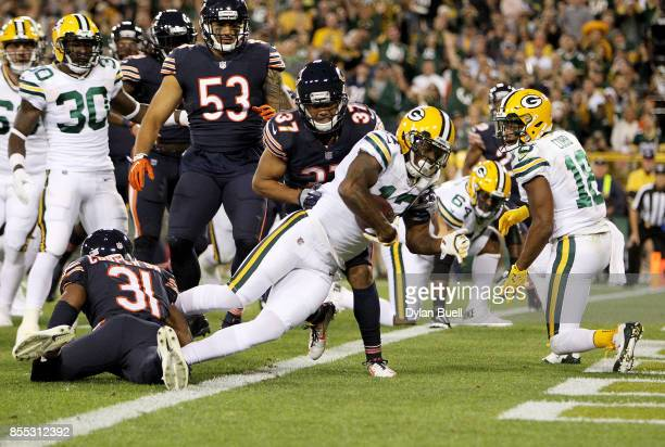 Davante Adams of the Green Bay Packers scores a touchdown in the first quarter against the Chicago Bears at Lambeau Field on September 28 2017 in...