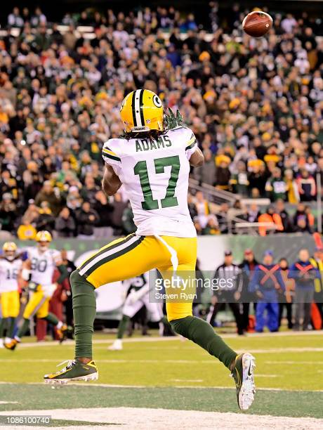 Davante Adams of the Green Bay Packers scores the game winning touchdown reception during overtime against the New York Jets at MetLife Stadium on...
