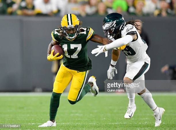 Davante Adams of the Green Bay Packers takes on Avonte Maddox of the Philadelphia Eagles in the first quarter at Lambeau Field on September 26 2019...