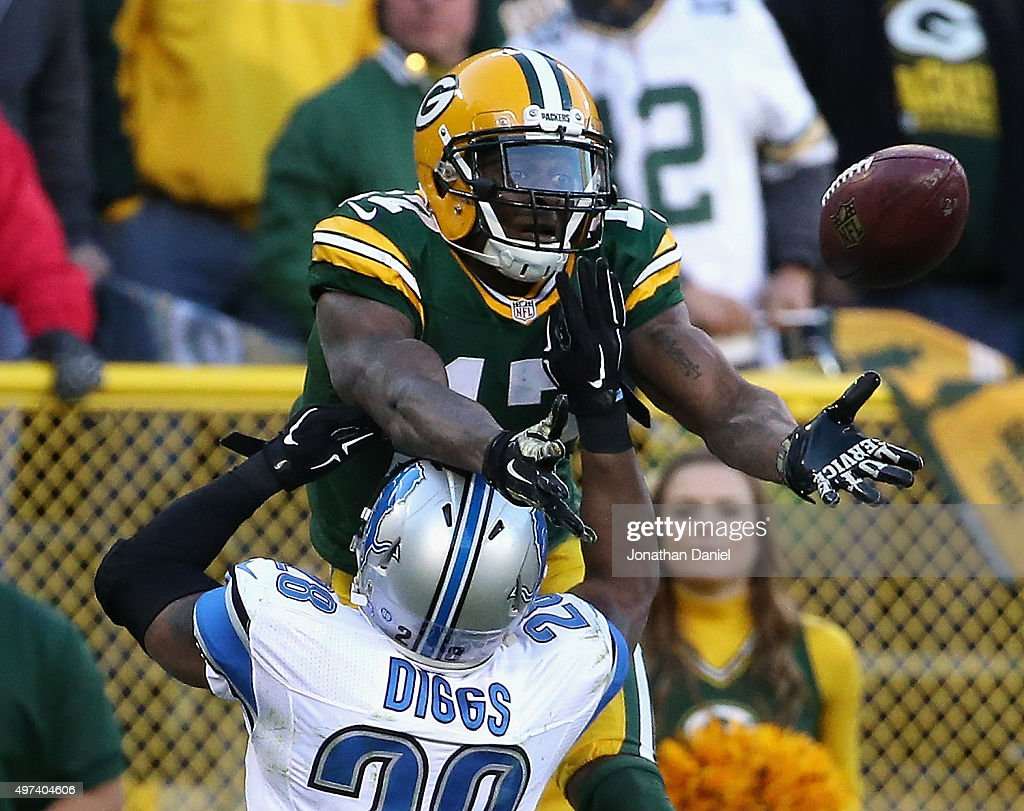 Davante Adams #17 of the Green Bay Packers tries to make a cacth over Quandre Diggs #28 of the Detroit Lions at Lambeau Field on November 15, 2015 in Green Bay, Wisconsin. The Lions defeated the Packers 18-16.