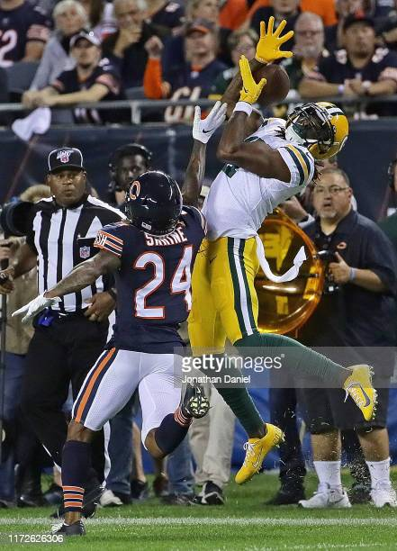 Davante Adams of the Green Bay Packers tries unsuccessfully to catch a pass under pressure from Buster Skrine of the Chicago Bears at Soldier Field...