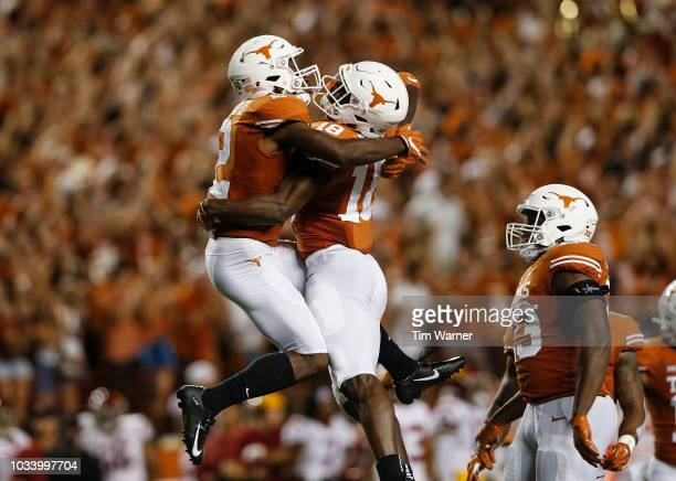 Davante Davis of the Texas Longhorns celebrates with Kris Boyd of the Texas Longhorns after a first half interception against the USC Trojans at...