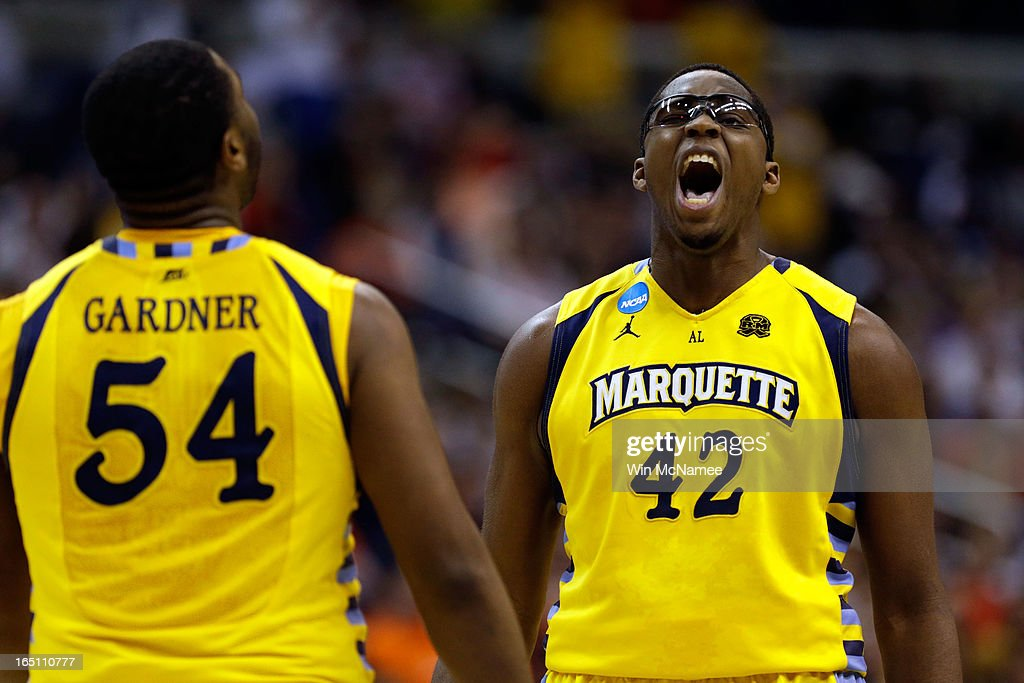 Davante Gardner #54 and Chris Otule #42 of the Marquette Golden Eagles react after a play against the Syracuse Orange during the East Regional Round Final of the 2013 NCAA Men's Basketball Tournament at Verizon Center on March 30, 2013 in Washington, DC.