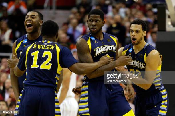 Davante Gardner Derrick Wilson Jamil Wilson and Trent Lockett of the Marquette Golden Eagles reacts after a play against the Miami Hurricanes during...