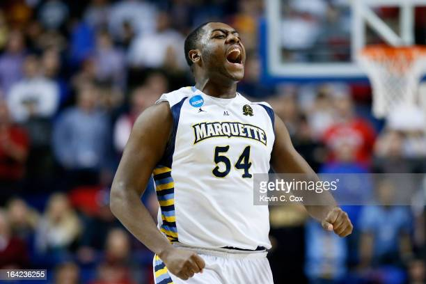 Davante Gardner of the Marquette Golden Eagles celebrates a gamewinning basket by teammate Vander Blue against the Davidson Wildcats during the...