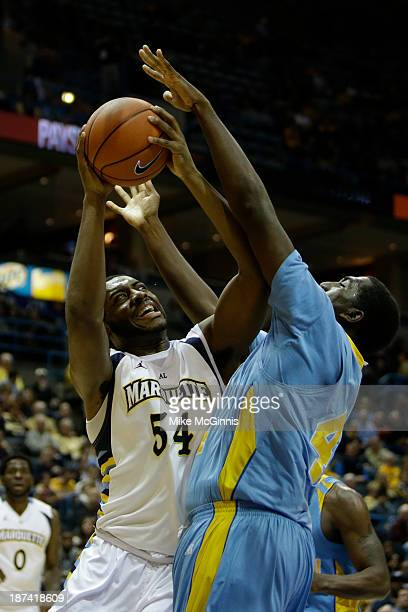 Davante Gardner of the Marquette Golden Eagles gets fouled going to the rim during the first half of play against the Southern Jaguars against the...