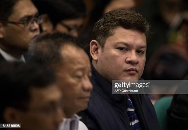 Davao City Vice Mayor Paolo Duterte son of Philippine President Rodrigo Duterte takes an oath as he attends a senate hearing in Manila on September 7...