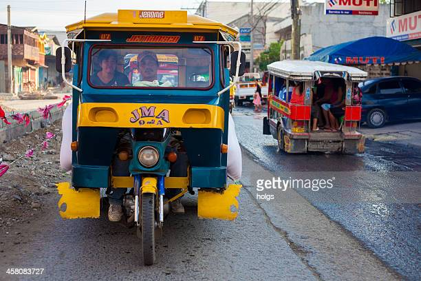 "davao, philippines: ""tricycle"" made up of a motorcycle with carriage - davao city stock photos and pictures"