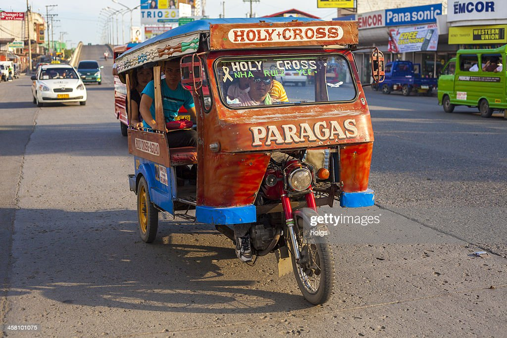 "Davao, Philippines: ""Tricycle"" made up of a motorcycle with carriage : Stock Photo"