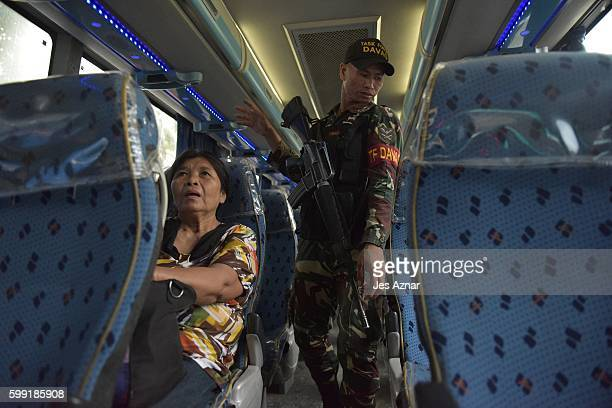 Davao police and soldiers conduct vehicle searches on key checkpoints in the city, on September 4, 2016 in Davao City, Philippines. The Philippine...