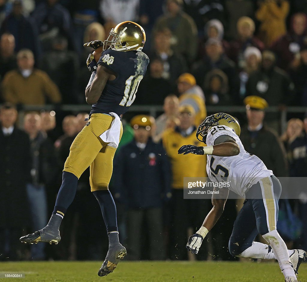DaVaris Daniels #10 of the Notre Dame Fighting Irish makes a catch in front of Jason Hendricks #25 of the Pittsburgh Panthers at Notre Dame Stadium on November 3, 2012 in South Bend, Indiana. Notre Dame defeated Pittsburgh 29-26 in triple overtime.