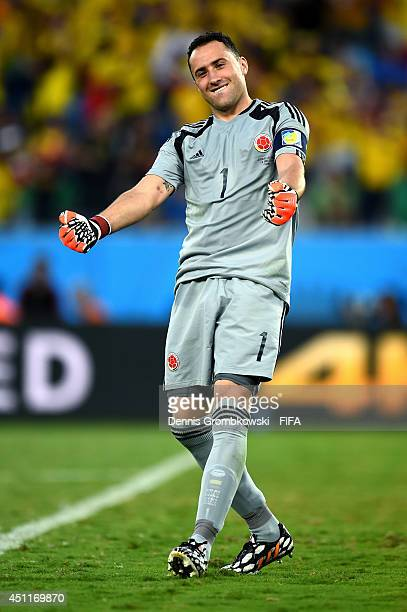 Davbid Ospina of Colombia celebrates his team's second goal scored by Jackson Martinez during the 2014 FIFA World Cup Brazil Group C match between...
