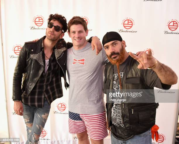 Dave 1 of Chromeo Vice President of Budsweiser Brian Perkins and PThugg of Chromeo pose backstage at the 2014 Budweiser Made In America Festival at...