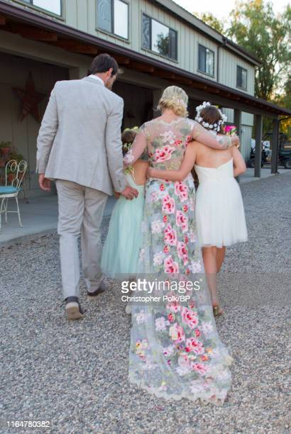 Dave Abrams Fiona Facinelli Jennie Garth and Luca Facinelli are set at a wedding at a private residence July 11 2015 in Santa Ynez California