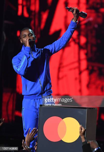 Dave accepts the award for Mastercard Album of The Year during The BRIT Awards 2020 at The O2 Arena on February 18 2020 in London England