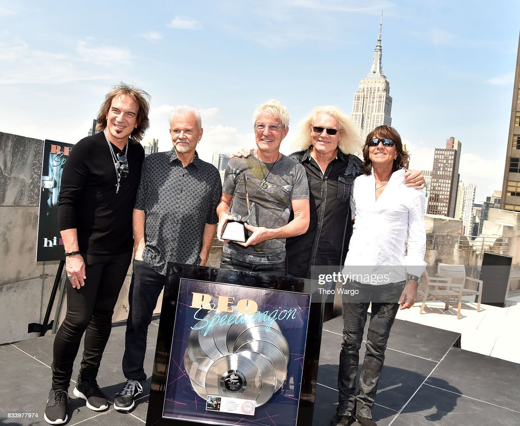 Dave Amato, Neal Doughty, Kevin Cronin, Bruce Hall and Bryan Hitt of REO Speedwagon attend REO Speedwagon Receives RIAA Diamond Award For 'Hi Infidelity' at Sony Music on August 17, 2017 in New York City.