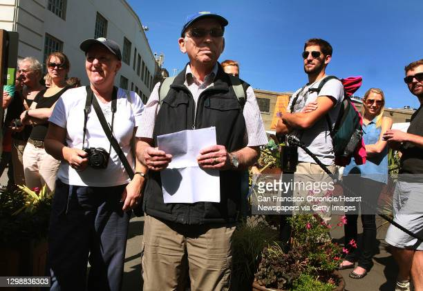 Dave and Jenny Waller from England wait in line to get a refund for tickets bought last weekend at Alcatraz ferry landing during the federal...