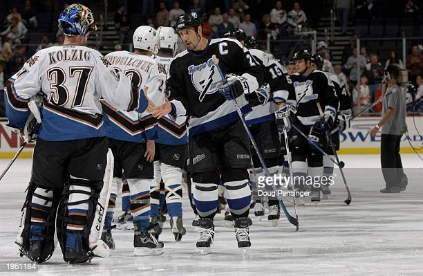 Dave Andreychuk and the Tampa Bay Lightning are congratulated by Olaf Kolzig and the Washington Capitals after game six of the 2003 Eastern...