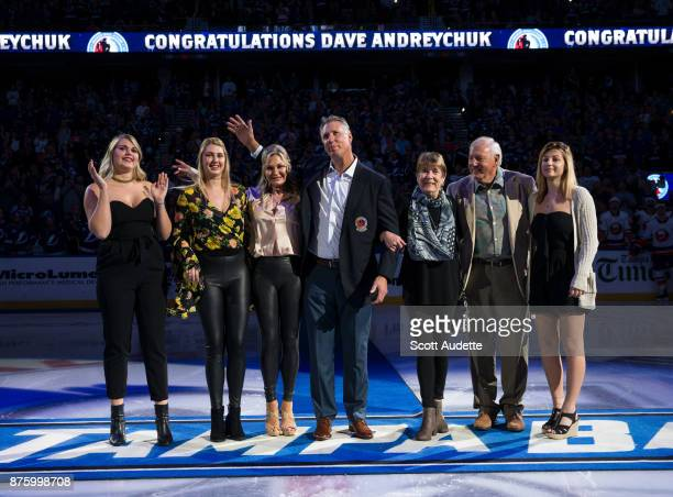 Dave Andreychuk is honored by the Tampa Bay Lightning after being inducted into the Hockey Hall of Fame before the game against the New York...