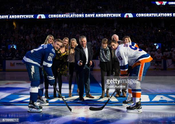 Dave Andreychuk is honored by the Tampa Bay Lightning after being inducted into the Hockey Hall of Fame and drops the puck for the ceremonial puck...