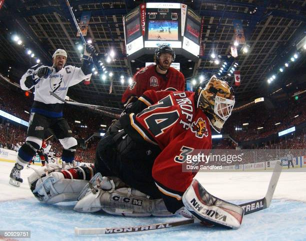 Dave Andreychuk of the Tampa Bay Lightning celebrates after teammate Brad Richards scored the team's first goal past goaltender Miikka Kiprusoff of...
