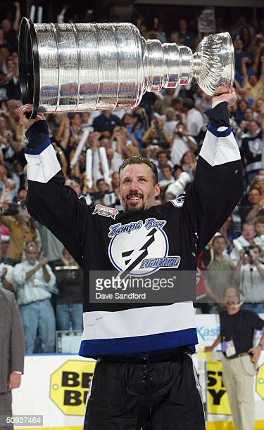 Dave Andreychuk of the Tampa Bay Lightning celebrates with the Stanley Cup after defeating the Calgary Flames 21 in game seven of the NHL Stanley Cup...