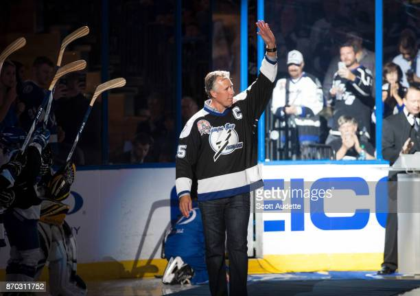 Dave Andreychuk waves to fans as the Tampa Bay Lightning honor the 2004 Stanley Cup Champions as part of their 25th anniversary celebration before...