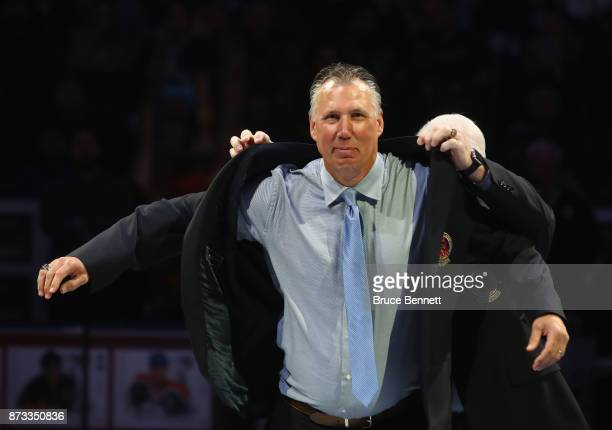 Dave Andrychuk is honored for his induction into the Hall of Fame prior to the Legends Classic game at the Air Canada Centre on November 12 2017 in...