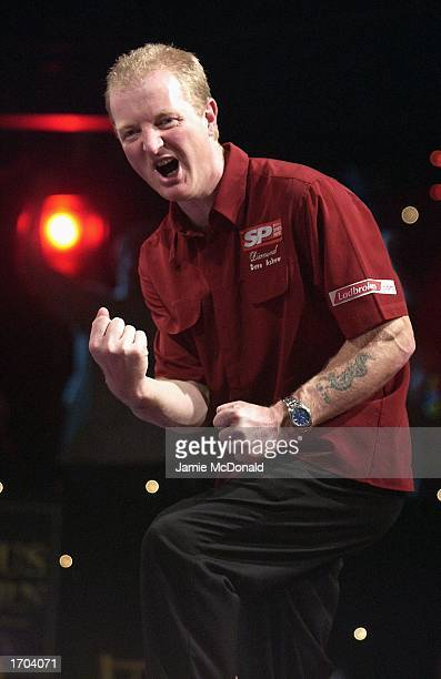Dave Askew celebrates during his second round match against Steve Beaton during the PDC Ladbrokescom World Darts Championships at the Circus Tavern...