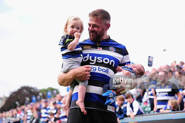 Dave Attwood of Bath Rugby celebrates victory with his children during the Aviva Premiership match between Bath Rugby and Newcastle Falcons at the...